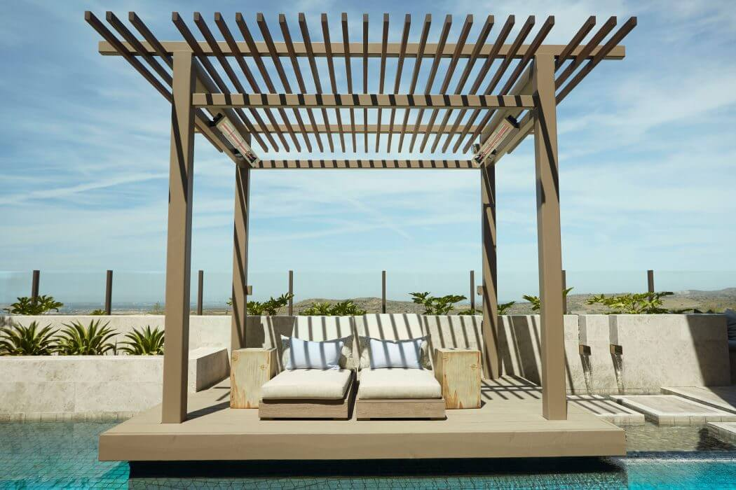 Infratech's SL-Series Slimline heaters offer efficient heat without obstructing this poolside pergola.