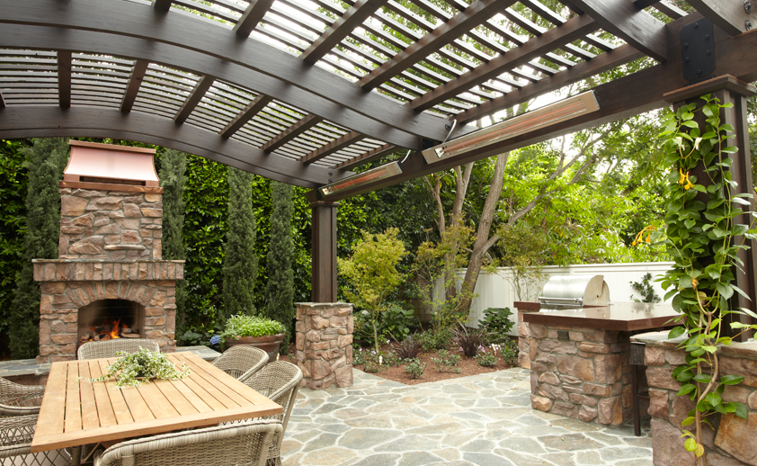 Outdoor entertainment area with wall mounted SL-Series heaters.