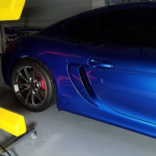 Brilliant blue sports car baking under Infratech automotive heaters.