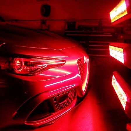 An Alfa Romeo Giulia Quadrifoglio gets full and even coverage of CQuartz Finest and SunTek Films by employing multiple Infratech curing systems.