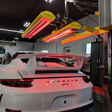 A Porsche GT3 receives a pristine white gleam courtesy of our SR-6000 short wave system.