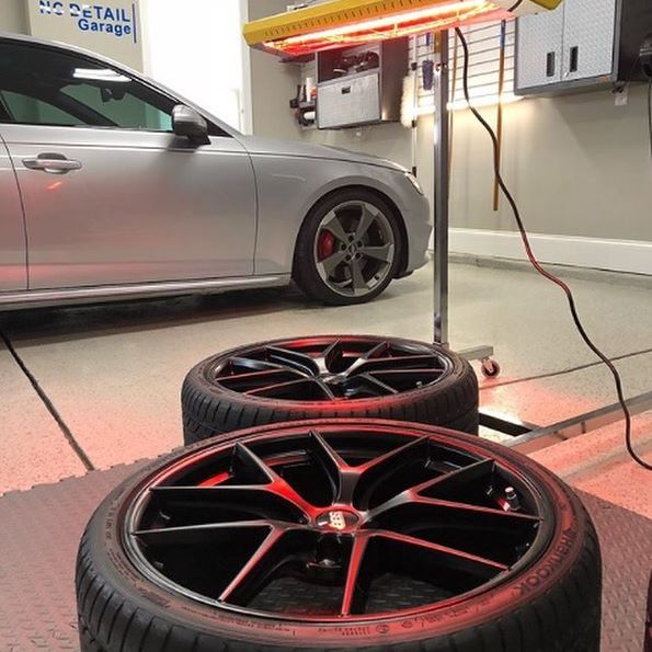 Curing a set of wheels with a Gyeon Quartz ceramic coating.