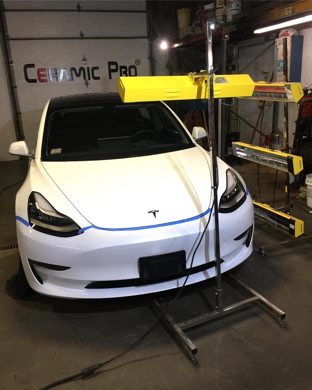 Multiple Infratech lamps work to get this gleaming Tesla Model 3 ready for harsh New England weather.