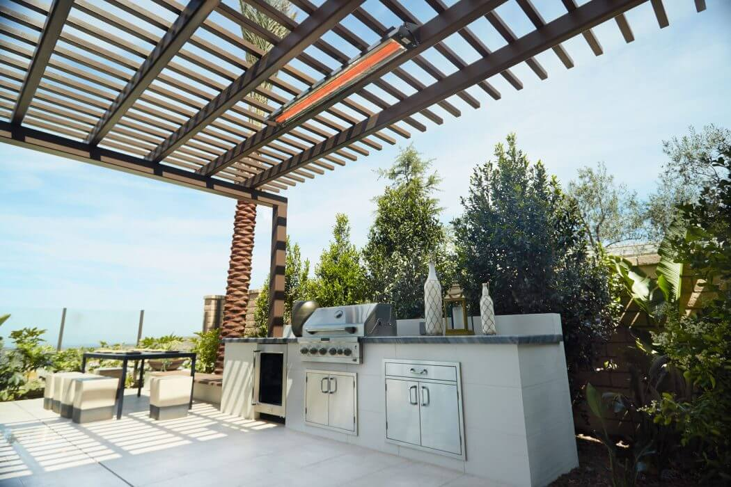 Dual element WD-Series heaters installed in outdoor cooking and seating space.