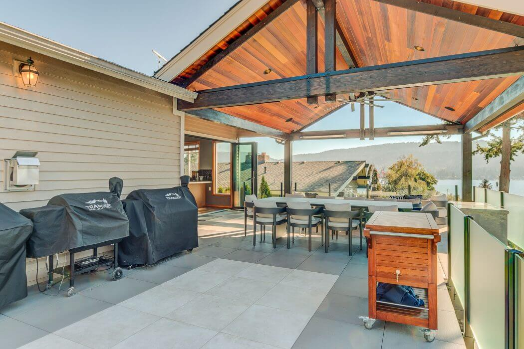 Outdoor deck for entertaining installed with wall mount Slimline SL-Series heaters.