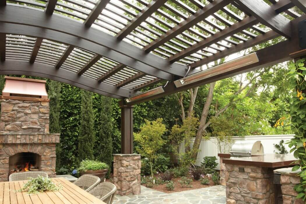 Outdoor living area with wall mounted SL-Series heaters make for the perfect entertaining space year-round.