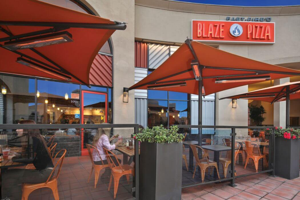 Blaze Pizza in Newport Beach, CA features pole mounted SL-Series heaters for the outdoor patio seating area.