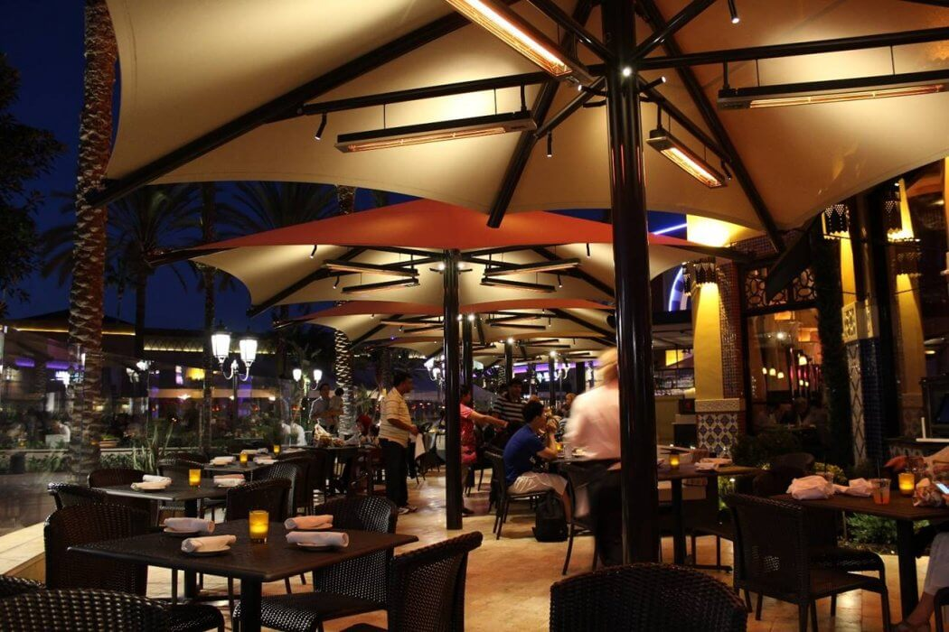 This custom slimline heater installation provides unobtrusive year-round comfort to The Cheesecake Factory Irvine outdoor dining area.