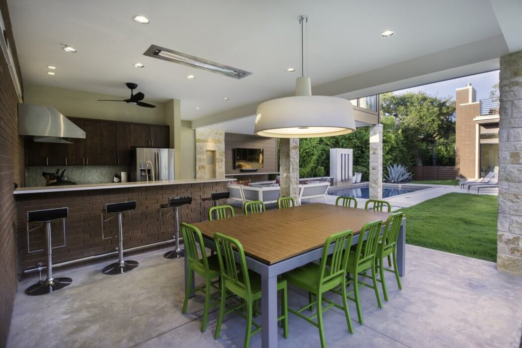 Designer friendly flush mount heaters are functional and efficient in this outdoor kitchen space.