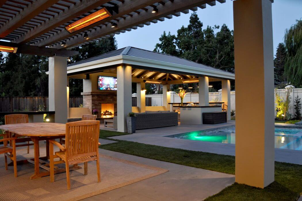 Wall mounted W-Series single element heaters bring year-round comfort to this residential backyard patio design.