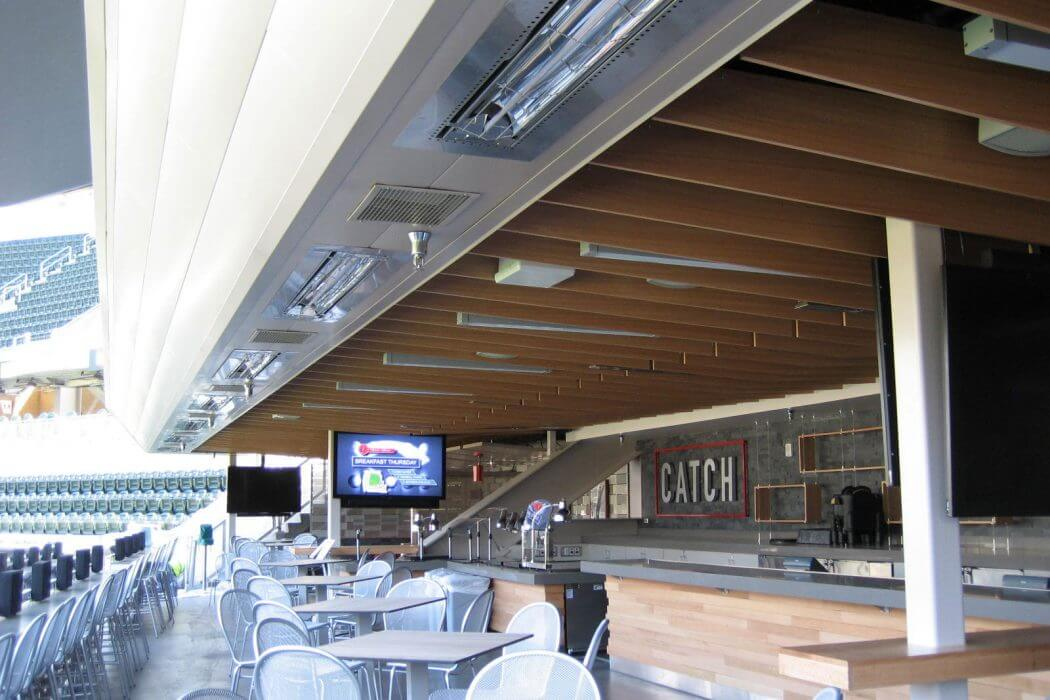 Infratech W-Series heaters bring comfort and ambiance to outdoor dining area, featured at the Minnesota Twins Stadium.