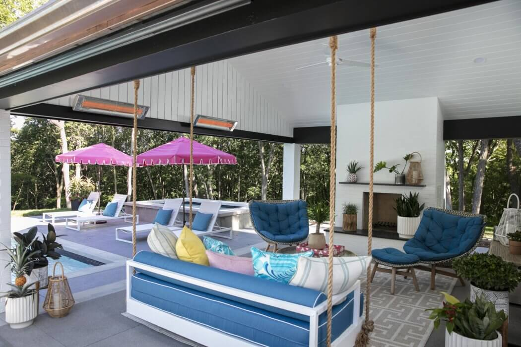 CD-Series heaters feature inset mounting brackets to appear floating on the wall in this poolside cabana.
