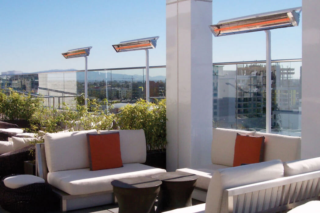 Hotel rooftop patio with custom pole mounted W-Series heaters.