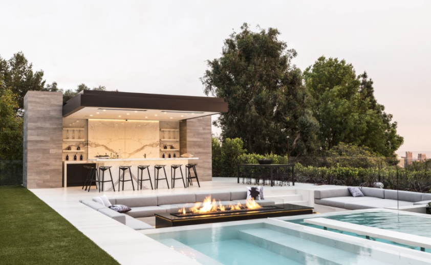 Flush mounted W-Series heaters over look the pool in Beverly Hills dream house. Photo via WSJ.